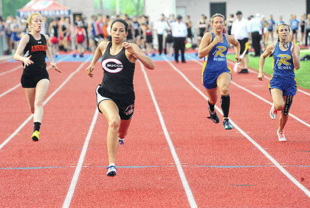 Mike Ullery/AIM Media Covington's Breanna Kimmel wins her heat of the 100 at the Division III meet Tuesday at Piqua.