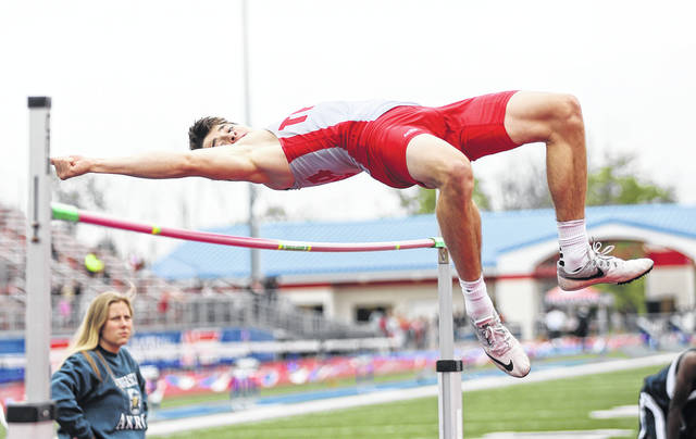 Photo courtesy Lee Woolery | Speedshot Photo Troy's Nick Mittelstadt competes in the high jump at the Division I district meet Friday in Piqua.