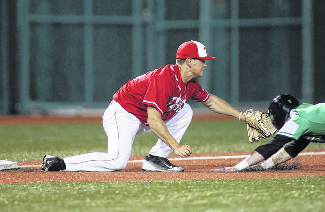 Photo courtesy Lee Woolery/Speedshot Photo Troy third baseman Matt Bigley tags out a Northmont runner attempting to steal third base on a throw by catcher Keiran Williams during the Division I sectional final Saturday night at Wright State University's Nischwitz Stadium.