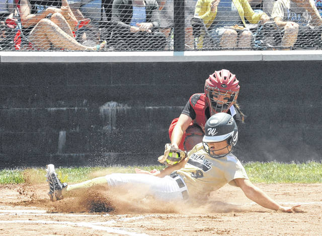 Josh Brown/Troy Daily News Newton catcher Maddi Weaver tags out Parkway's Macy Henkle at the plate during the first inning of a Division IV regional semifinal game Wednesday in Greenville.