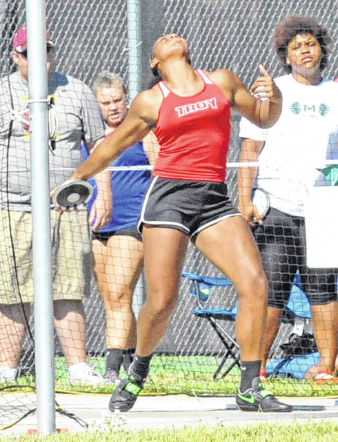 Josh Brown/Troy Daily News file Troy's Lenea Browder throws the discus at the Division I regional meet Friday at Wayne High School.