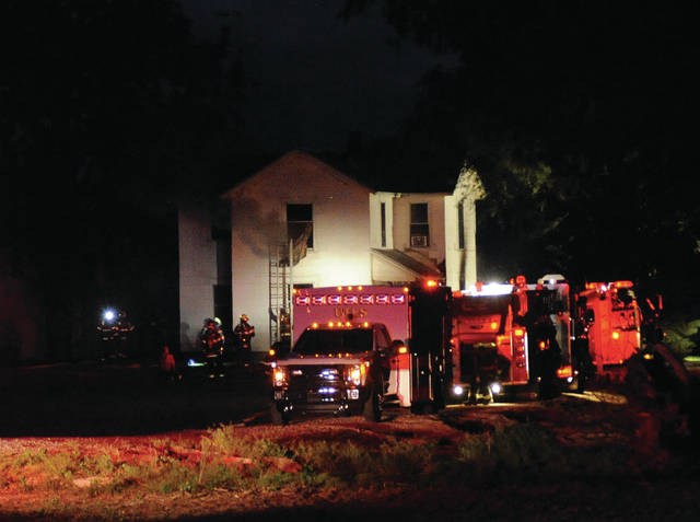 Mike Ullery | Daily Call Firefighters battle a Friday night house fire at 11173 Frederick-Garland Road.