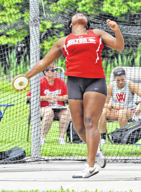 Josh Brown/Troy Daily News Milton-Union's Beyonce Bobbitt competes in the discus at the Division II regional meet Saturday in Piqua.