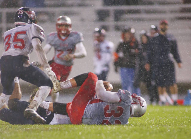 Photo Courtesy of Lee Woolery | Speedshot Photo Troy and Piqua battle in a 2017 Greater Western Ohio Conference football contest. Beginning in 2019, Troy, Piqua and Tippecanoe will join seven other regional schools in forming the Miami Valley League.