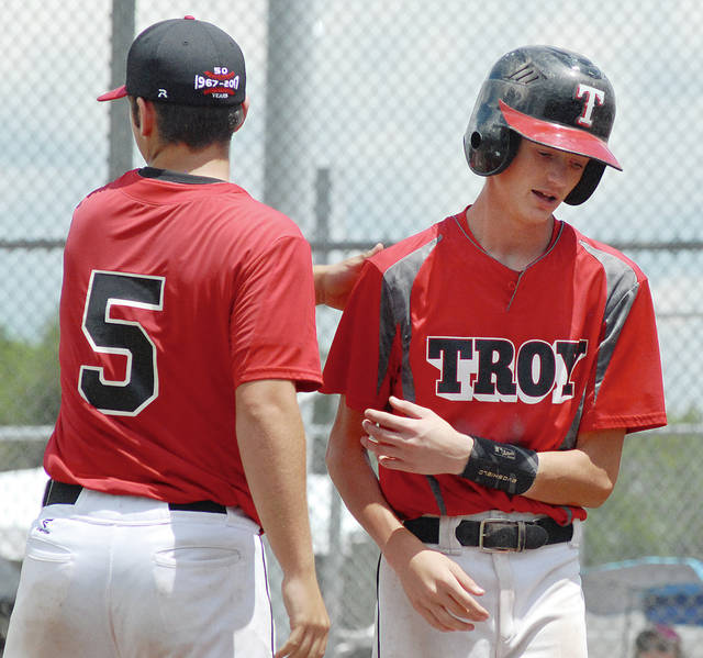Anthony Weber/Troy Daily News file Troy Post 43's Austin Kendall (1) is congratulated by Keaton Mohler (5) after he scored a run against Pemberville Legion during a game last season at Duke Park.