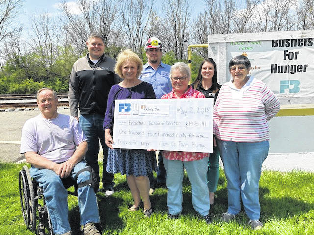From left, Miami County Farm Bureau President Bill Wilkins, board members J.D. Winteregg and Cynda Renner, Troy Elevator Safety Coordinator Tom Treon, Bradford Resource Center volunteer Mary Alice Yount, MCFB Organizational Director Melinda Lee, and volunteer Debby Jess. The Bradford Resource Center received $1,495.91 through the Bushels for Hunger program.