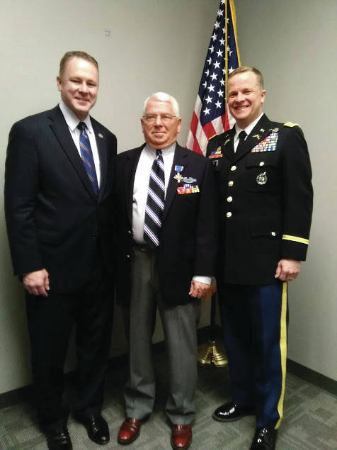 Provided Photo Michael L. DeHart, center, is joined by 8th District Congressman Warren Davidson and Army Col. Carter Price at Davidson's office in Troy, where DeHart was presented with a Distinguished Service Cross on May 7.