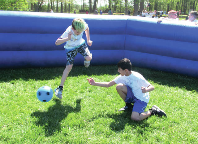 "Cody Willoughby | Troy Daily News Left to right, Zander Bailen and Parth Rhapet play ""Gagaball"" during the Hug the Earth Festival on Thursday, May 10 at Stillwater Prairie Reserve."