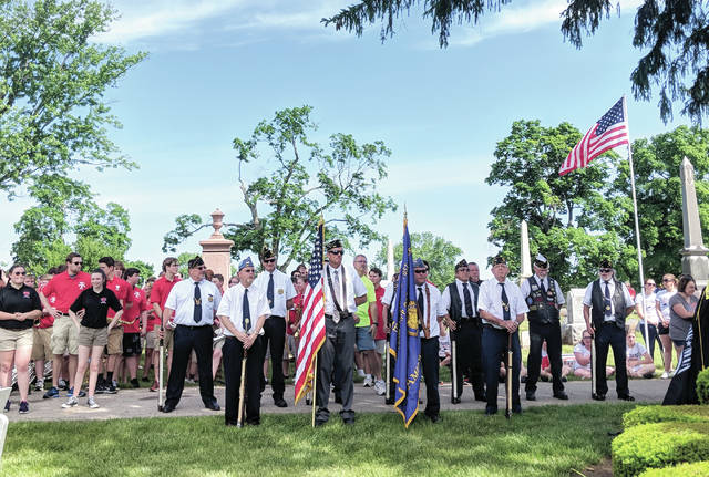 Cecilia Fox | Weekly Record Herald Tipp City and Monroe Township commemorated Memorial Day with a parade and service in Maple Hill Cemetery. The parade was led by the Tipp City American Legion Post and included military vehicles, local scout troops and local first responders.