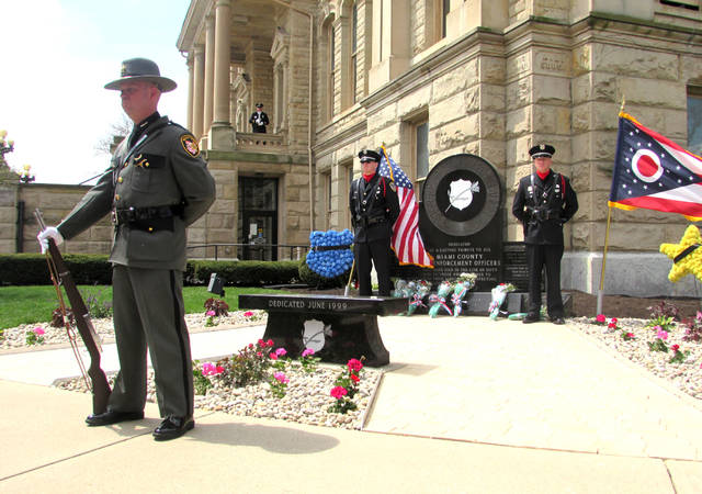 Cody Willoughby | Troy Daily News Honor guard members stand at the Miami County Police Memorial during the Miami County Police Memorial Day service on Wednesday on the plaza at Miami County Courthouse in Troy.