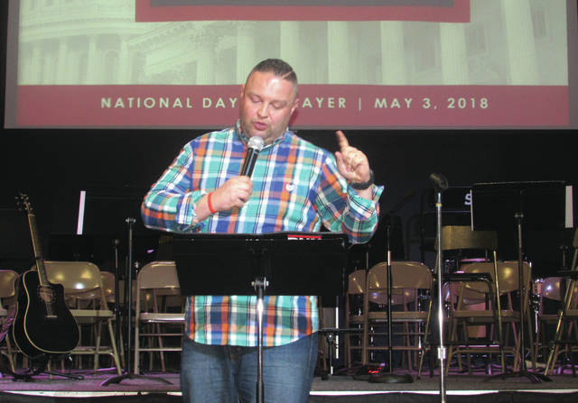 "Cody Willoughby | Troy Daily News Guest speaker Ryan Little addresses the audience during the ""National Day of Prayer"" service at Troy Christian High School on Thursday."