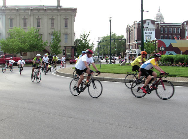"Cody Willoughby | Troy Daily News Dozens of cyclists roll through the Public Square during the annual ""Ride of Silence,"" an commemorative community bicycle ride to honor those who killed or injured while cycling on public roadways. Participants began their ride at J&D Bicycles, who hosted the event for a third consecutive year, and followed a 12-mile route through the streets of Troy. The ""Ride of Silence"" began in 2003, and is held on the third Wednesday of each May at hundreds of locations across all 50 states. For more information, visit www.rideofsilence.org."