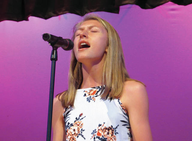 "Cody Willoughby | Troy Daily News Olivia Tyre performs Panic at the Disco's ""This is Gospel"" during the 2018 Troy High School Talent Show on Friday."