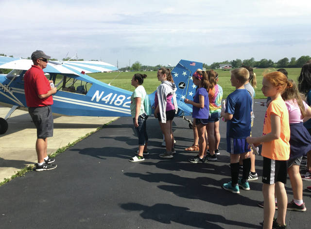 Provided Photo Sean Saddler, corporate pilot for Hartzell Propeller, Inc., provides an orientation to Van Cleve sixth graders on the functions of a single-engine prop plane during 'Aviation Invasion' on Monday at WACO Air Museum.