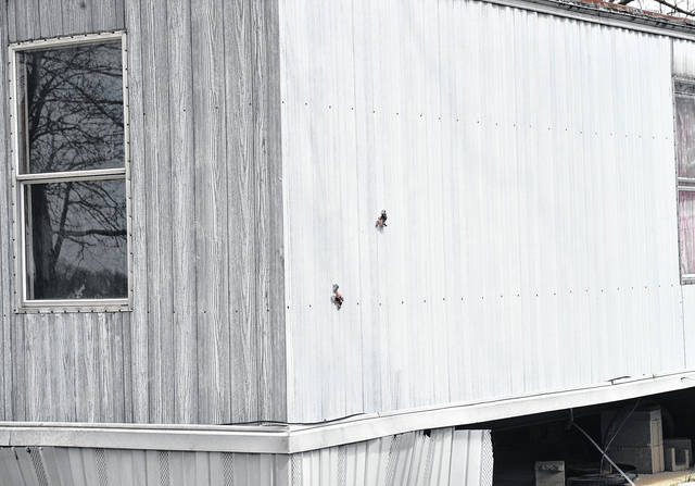 Mike Ullery | AIM Media file photo The exit holes from two apparent shotgun blasts in a trailer at the Paris Court trailer park in the 10000 block of North County Road 25-A, north of Piqua, where a young child allegedly fired two rounds from a shotgun on April 9.