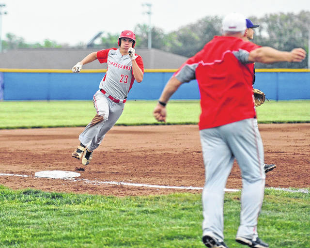Josh Brown/Troy Daily News file Tippecanoe's Zach Losey is waved home by coach Bruce Cahill during the Red Devils' sectional final win over Bellbrook. Cahill was named the All-Ohio Coach of the Year and Losey was named All-Ohio first team.