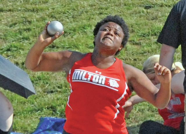 Josh Brown/Troy Daily News Milton-Union's Beyonce Bobbitt competes in the shot put during the Division II state meet Saturday at Jesse Owens Memorial Stadium.
