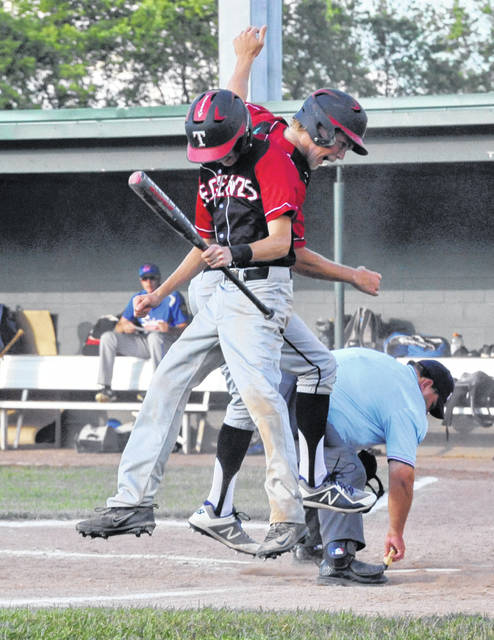 Josh Brown/Troy Daily News Troy Post 43's Austin Kendall (holding bat) and Frank Gmuca celebrate after Gmuca drove Kendall in to score on a squeeze bunt during a game against Sidney Post 217 Wednesday at Duke Park.