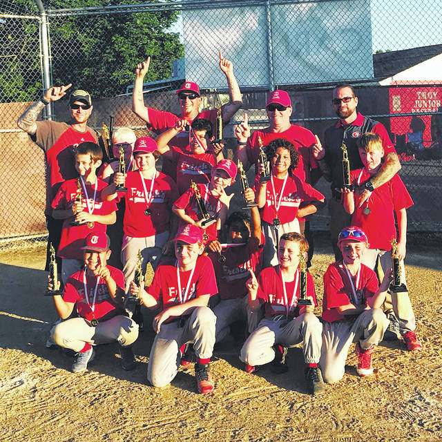 Provided photo Team Frisch's won the 2018 Troy Junior Baseball minor league championship this spring, going undefeated during the regular season and the tournament. The team is: coaches — Chuck Gump, Josh Schlater, Chris Masten and Mike Gorman. Top row — Christian Huffgarden, Jack Sedlak, Gino Marin, Noah Music, Bryce Lehman, Bryson Block and Aidan Gorman. Bottom row — Eathan Atkins Gump, Rylan Block, Jocelyn Trout, Kael Tompkins and Kayden Wesco.