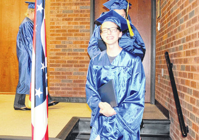 Provided photo Aspire graduate Thomas Davidhizor of Troy exits the stage after receiving his diploma.