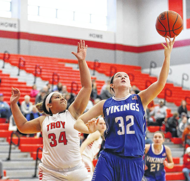 File photo courtesy Lee Woolery/Speedshot Photo Miami East's Haley Howard grabs a rebound during a game against Troy during the 2017-18 season.