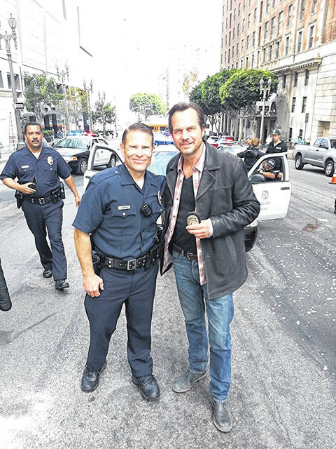 "Provided photo Miami County native Jack Mahrt, left, a current federal law enforcement officer and aspiring actor, on the set of the pilot for the TV show ""Training Day"" with actor Bill Paxton."