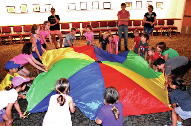 Cody Willoughby   Troy Daily News Junior naturalists at Brukner Nature Center participate in parachute activities during Summer Camp for Kids on Thursday.