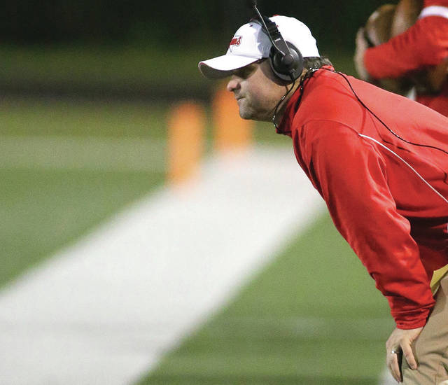 Photo Courtesy of Lee Woolery | Speedshot Photo Troy football coach Matt Burgbacher watches on from the sidelines during a game.