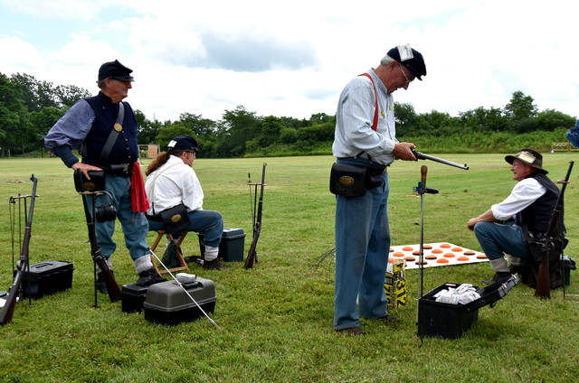 Cody Willoughby | Troy Daily News Members of the Dayton Area North South Skirmish Association prepare Civil War-era weapons to fire during the Civil War Skirmish on Saturday at VFW Post 6557 in Ludlow Falls.