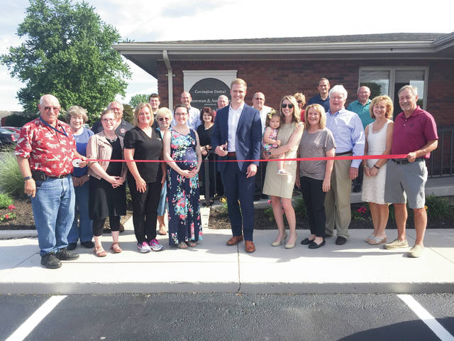 Provided photo Dr. Zach Stueve celebrates the opening of Covington Dental, 550 Mote Drive #1, with a ribbon-cutting, along with dental team and Chamber of Commerce members, and residents of the community.