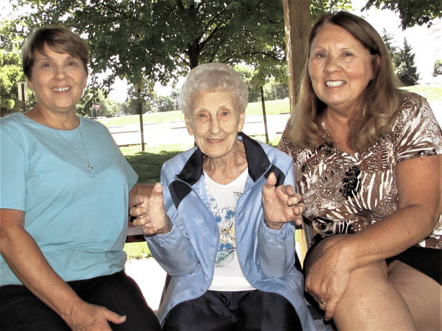 June Keim, center, shares her stories with her daughters Kathy Whidden, left, and Carol Walker, right at Troy Community Park last Friday. June will turn 100 years-old on June 25.