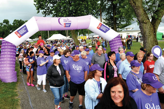 "Cody Willoughby | Troy Daily News Hundreds of survivors, along with their family and friends, participate in the ""survivor's lap"" during the opening of Miami County's 24th annual Relay for Life on Friday at Miami County Fairgrounds."