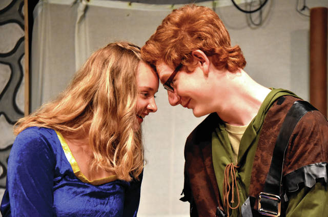 "Cody Willoughby | Troy Daily News Victoria Glover as Maid Marian and Brandon Allen as Robin Hood share a delightful moment in ""Robin Hood,"" the new children's production opening on Thursday at the Barn in the Park."