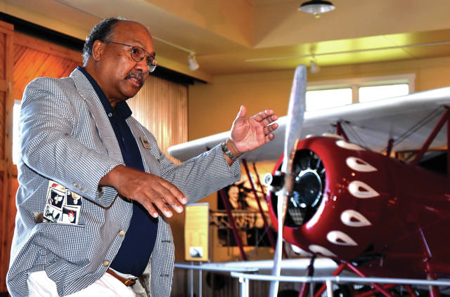 Humanities scholar Jim Armstead discusses aviation history at WACO Air Museum and Learning Center on Wednesday in Troy.
