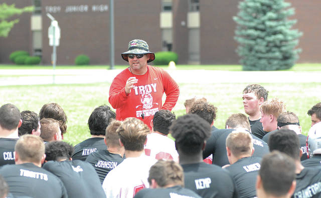 By David Fong | Troy Daily News Troy football coach Matt Burgbacher addresses his team Tuesday following the first day of summer camp.