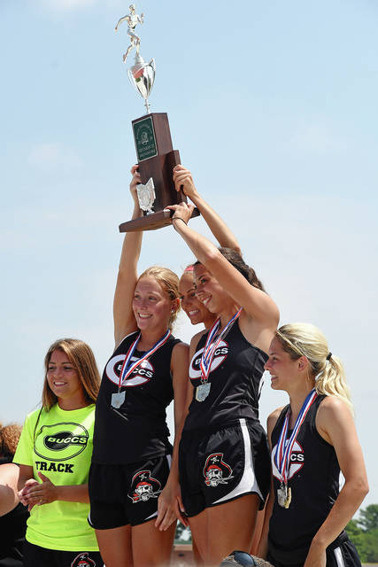 Photo courtesy Ben Robinson/GoBuccs.com The Covington girls track and field team holds the Division III state runner-up trophy Saturday at Jesse Owens Memorial Stadium.