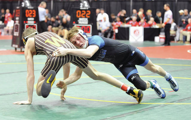 Josh Brown | Troy Daily News Graham Shore (right) captured a Division III state title for the Miami East wrestling team this past winter.
