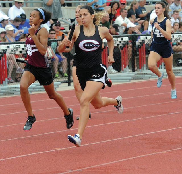 Mike Ullery/AIM Media file Breanna Kimmel runs at the state track and field meet. Kimmel and the Covington 4x400 relay recently finised seventh at the New Balance Nationals outdoor meet.