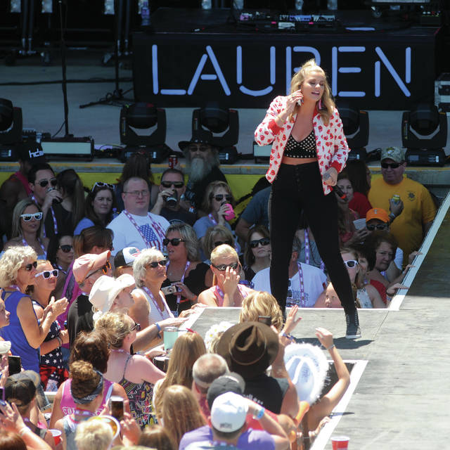 Lauren Alaina gets the crowd fired up as she opens on the main stage on Sunday.