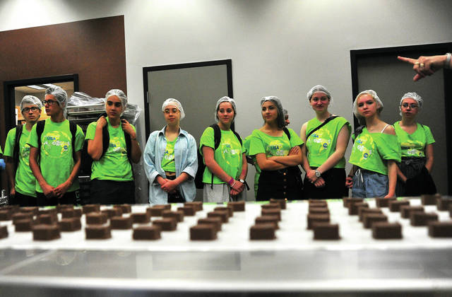 Mike Ullery | Daily Call Members of the 2018 CISV delegation to Piqua tour Winan's Chocolates and Coffees in Piqua last week during their visit to the area. A total of 25 students from 16 countries spent a week visiting with families in Miami County. CISV was established in 1946 as Children's International Summer Villages by Dr. Doris Allen, a specialist in growth and development.