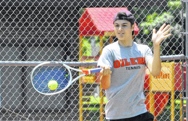 Josh Brown/Troy Daily News Shane Essick hits a forehand during a doubles match at the Frydell Junior Tennis Tournament Wednesday at Troy Community Park. Essick and John Wehrkamp won the first title of the tournament on Thursday, winning the boys 18u doubles bracket.