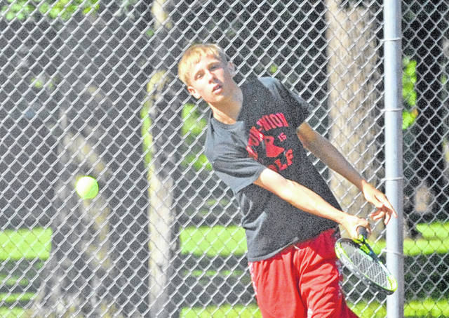Josh Brown/Troy Daily News Nick Brumbaugh slices a forehand return during the boys 18u singles title match at the Frydell Junior Tennis Tournament Friday at Troy Community Park.