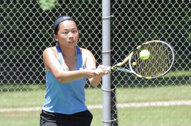 Josh Brown/Troy Daily News Xia Lin hits a backhand during Friday's round of the Frydell Junior Tennis Tournament at Troy Community Park. On Saturday, Lin won the girls 18u singles final.