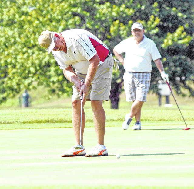 Josh Brown/Troy Daily News Jeff Poettinger putts during the first round of the Club Championship Saturday at Miami Shores Golf Course.