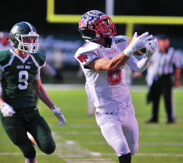 Mike Ullery | Daily Call file photo Piqua receiver Hayden Schrubb (right) hauls in a touchdown pass last season.