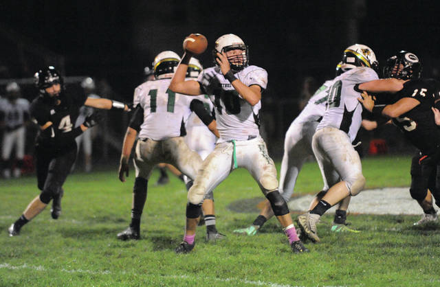 Josh Brown/Troy Daily News file Bethel quarterback Jacob Evans drops back to pass during a game at Covington last season.