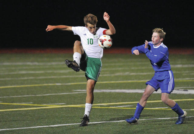 Josh Brown/Troy Daily News file Bethel's Korry Hamlin plays the ball out of the air in front of a Franklin Monroe defender during last fall's Division III sectional final at Eaton.