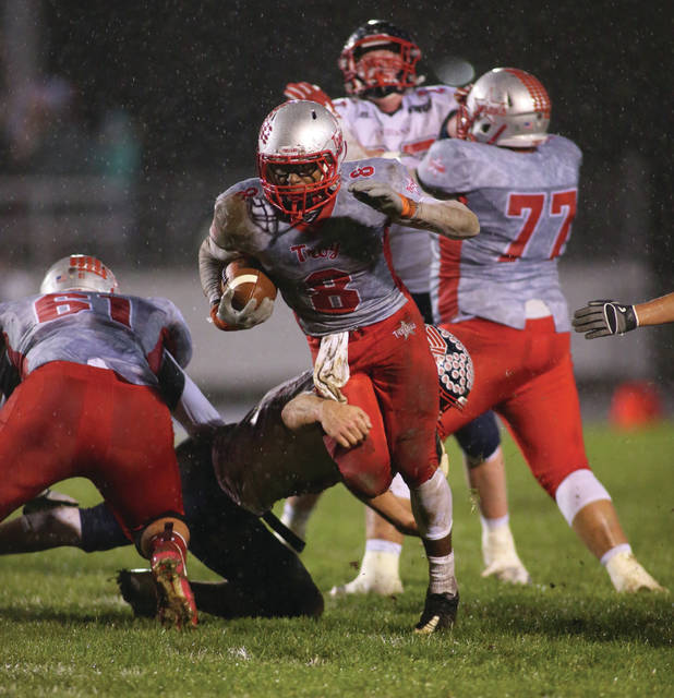File photo Courtesy of Lee Woolery | Speedshot Photo Troy's Jaydon Culp-Bishop (8) breaks free for a long run during a game against Piqua last year.