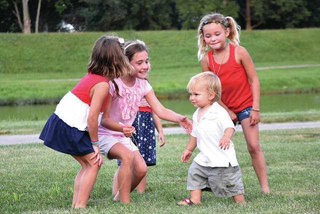Cody Willoughby | Troy Daily News From left, Piper Smith, 5, Laura Knight, 7, Lola Smith, 3, and Lily Smith, 6, of Troy greet Miles Rogers, 15 months, of Charlottesville, Virg. during Fourth of July festivities on Wednesday at Treasure Island Park.