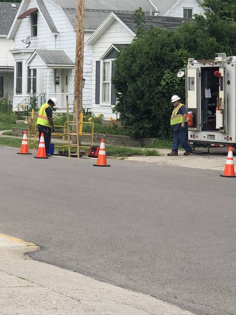 DP&L crews work to repair a damaged line in a man hole on Race Street on Friday morning. The power is expected to be restored by 6 p.m., according to officials.